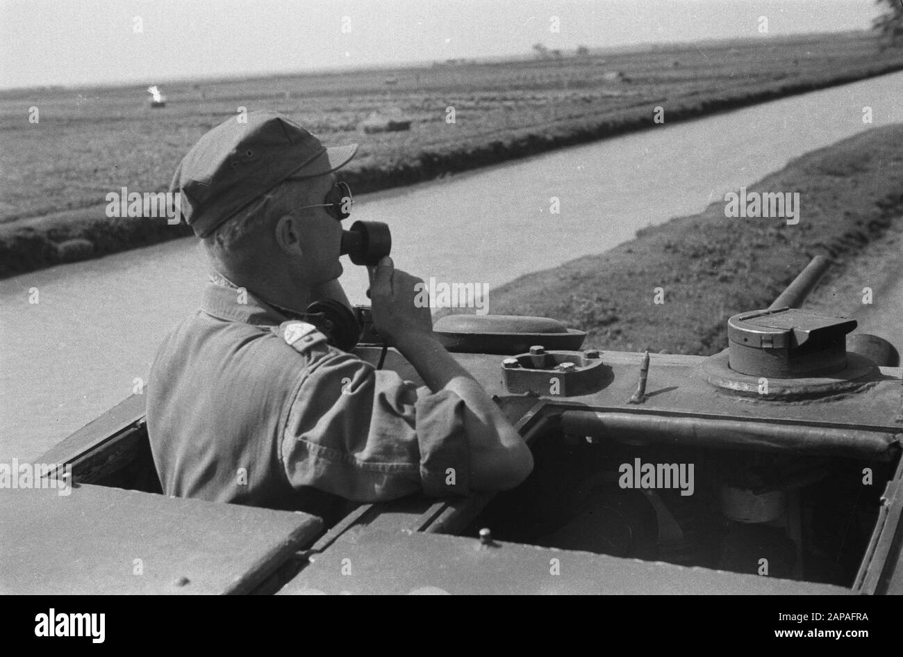 Action Cheribon Description: Cheribon: a Humber of the 6th Squadron Armored Cars in action during the advance to Cheribon. The commander of the vehicle speaks by a microphone Date: 26 July 1947 Location: Cheribon, Indonesia, Java, Dutch East Indies Stock Photo