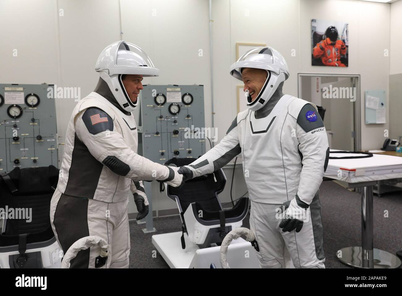 Combinaison SpaceX  - Page 5 Nasa-astronauts-bob-behnken-left-and-doug-hurley-shake-hands-after-suiting-up-in-spacex-spacesuits-in-the-astronaut-crew-quarters-at-kennedy-space-center-in-florida-on-january-17-2020-during-a-dress-rehearsal-ahead-of-the-companys-uncrewed-in-flight-abort-test-a-spacex-falcon-9-rocket-and-crew-dragon-spacecraft-will-lift-off-from-launch-complex-39a-on-the-flight-test-which-will-demonstrate-the-spacecrafts-escape-capabilities-in-preparation-for-crewed-flights-to-the-international-space-station-as-part-of-the-agencys-commercial-crew-program-behnken-and-hurley-are-slated-to-fly-on-the-c-2APAKE9