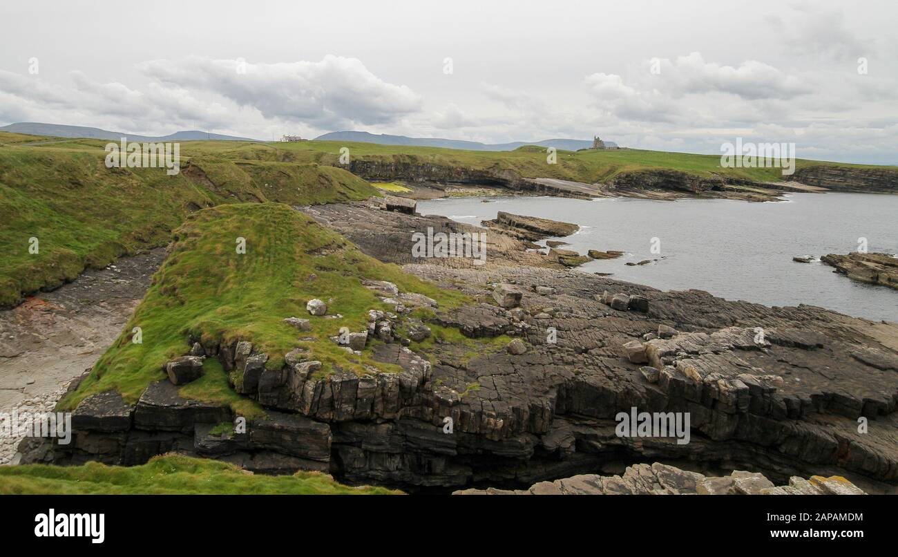 Rocky Coastal Headland On The Coast Of County Sligo At Mullaghmore Head With The Former Home Of Lord Mountbatten Classiebawn Castle On The Horizon Stock Photo Alamy