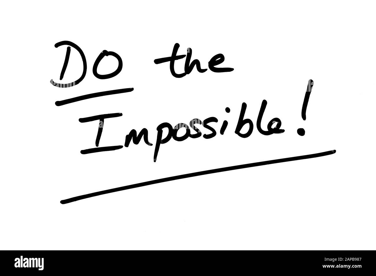 Do the Impossible! handwritten on a white background. Stock Photo