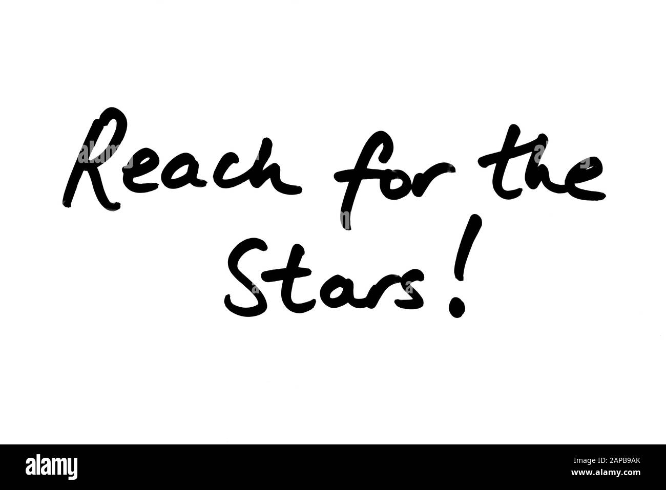 Reach for the Stars! handwritten on a white background. Stock Photo