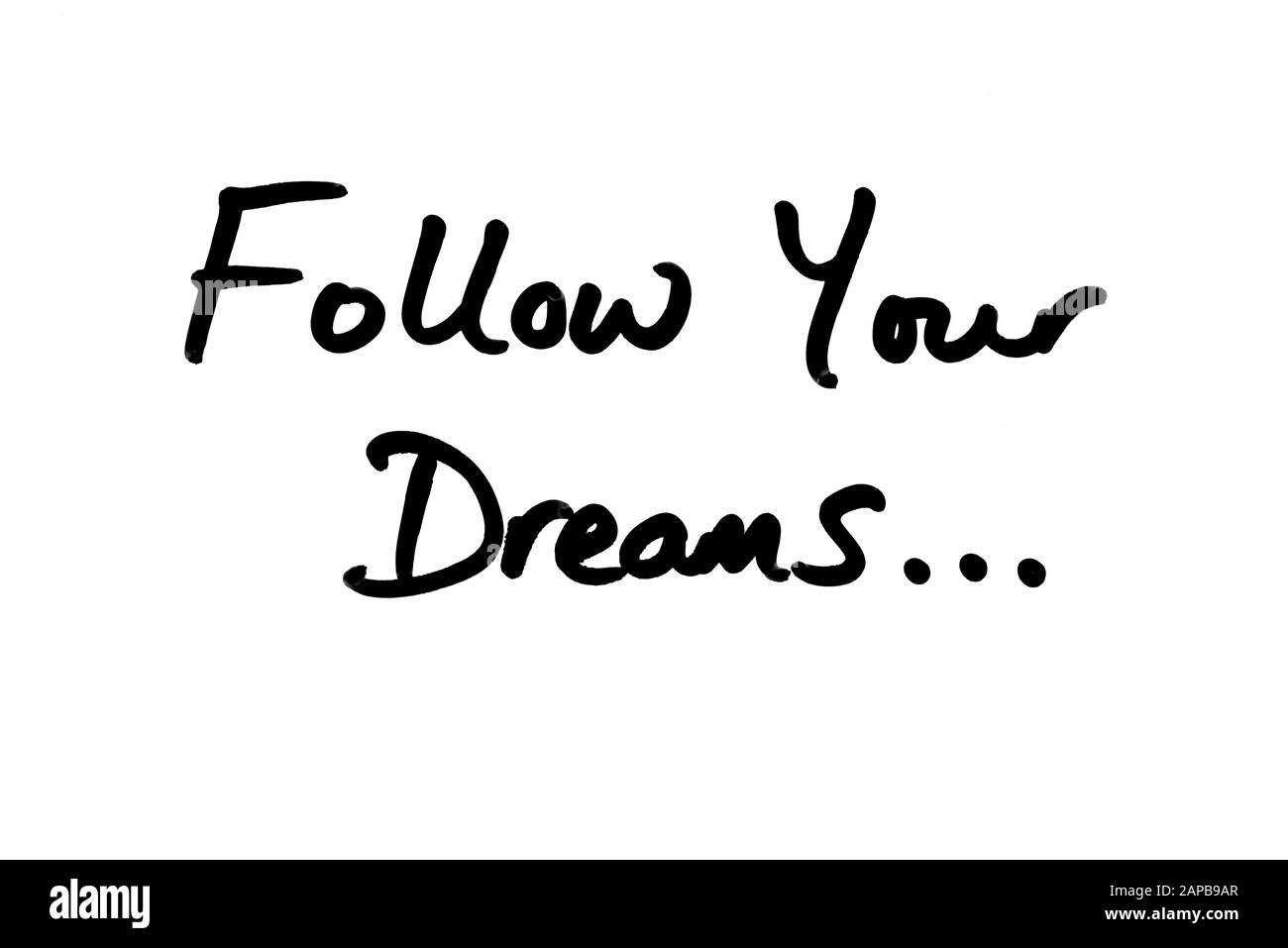 Follow Your Dreams… handwritten on a white background. Stock Photo