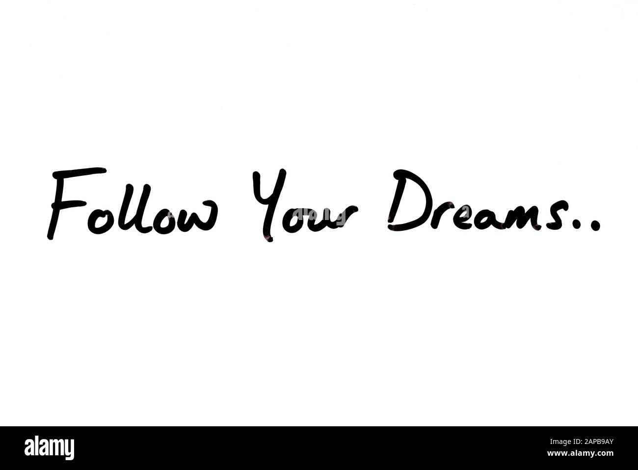 Follow Your Dreams.. handwritten on a white background. Stock Photo