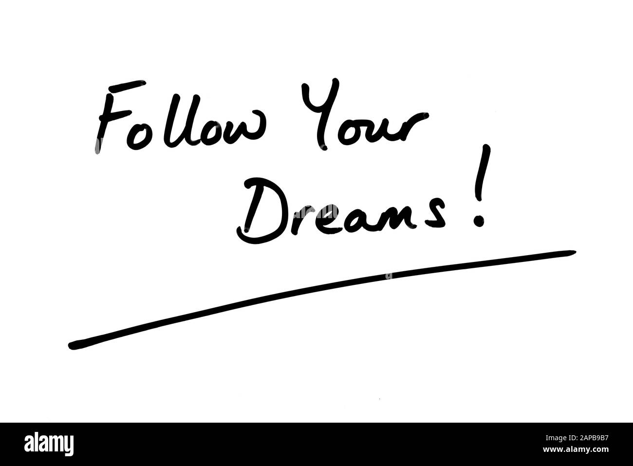 Follow Your Dreams! handwritten on a white background. Stock Photo