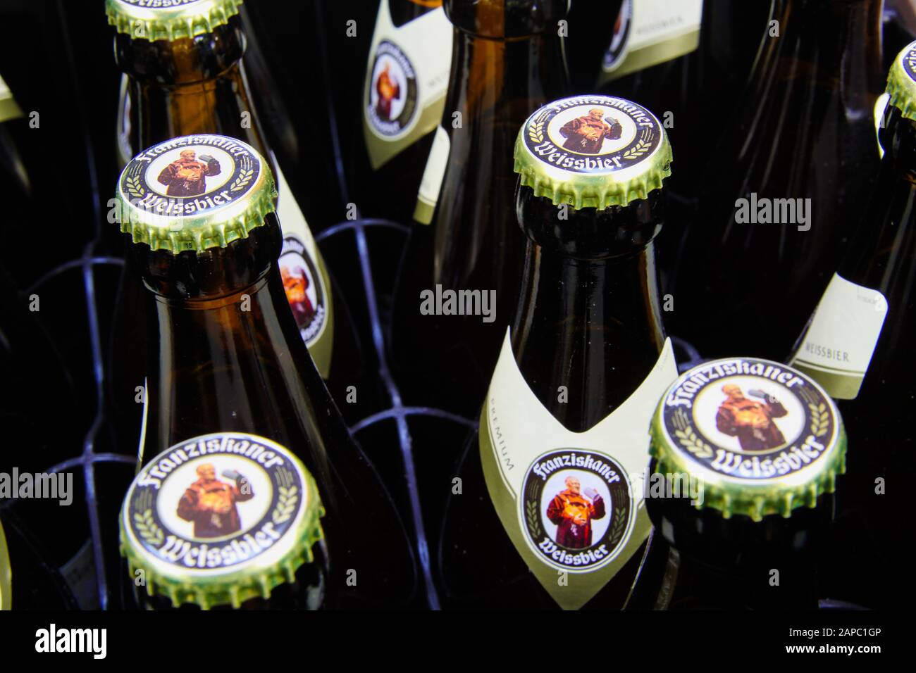 VIERSEN, GERMANY - AUGUST 21. 2019: Close up of bavarian Franziskaner wheat beer (Weissbier) bottles with crown caps in bottle case Stock Photo