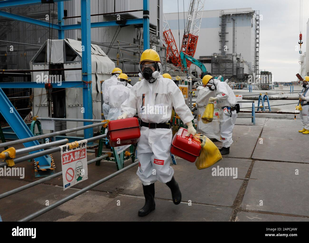 January 22, 2020, Okuma, Fukushima, Japan: Fully-protected workers leave Unit 2 reactor house after their work at tsunami-devastated Tokyo Electric Power Company (TEPCO) Fukushima Daiichi Nuclear Power Plant in Okuma town, Fukushima Prefecture, 22 January 2020. The storage tanks including water processed in the ALPS will be full around summer of 2022, TEPCO has told. Japanese government need to decide soon how manage the processed water still including tritium.  (Credit Image: © Kimimasa Mayama/POOL via ZUMA Wire) Stock Photo