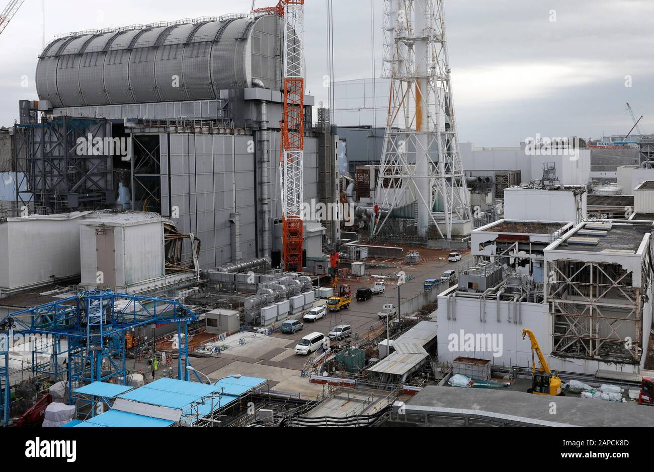 January 22, 2020, Okuma, Fukushima, Japan: Unit 3 (L) and Unit 4 (C-Rear) reactor houses are seen at tsunami-devastated Tokyo Electric Power Company (TEPCO) Fukushima Daiichi Nuclear Power Plant in Okuma town, Fukushima Prefecture, 22 January 2020. The storage tanks including water processed in the ALPS will be full around summer of 2022, TEPCO has told. Japanese government need to decide soon how manage the processed water still including tritium.  (Credit Image: © Kimimasa Mayama/POOL via ZUMA Wire) Stock Photo