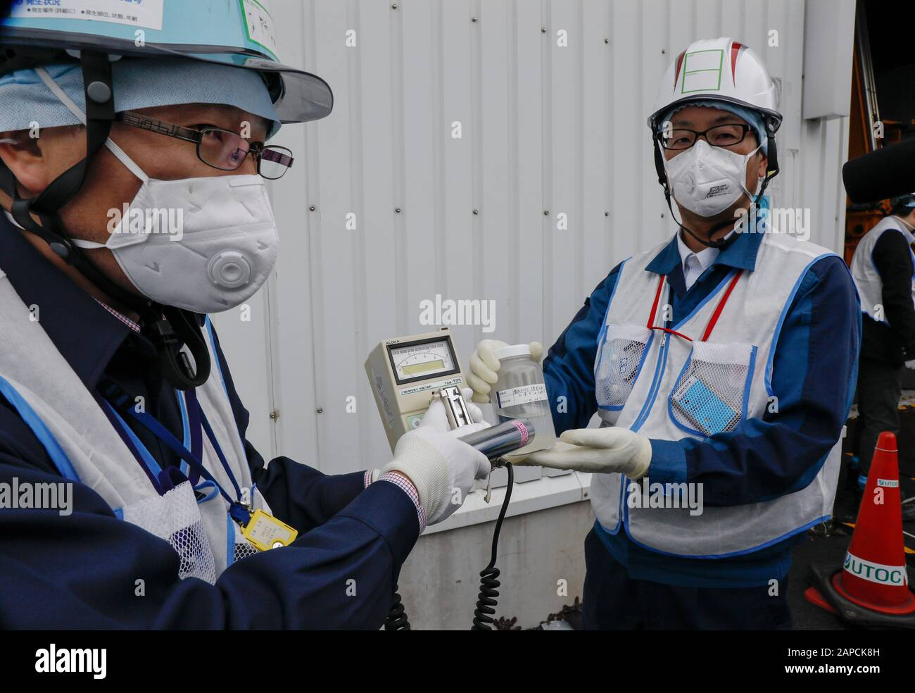 January 22, 2020, Okuma, Fukushima, Japan: Workers of  Tokyo Electric Power Company (TEPCO) Fukushima Daiichi Nuclear Power Plant demonstrate to measure radiation of water processed in ALPS(Multi-nuclide retrieval equipment) II in front of the ALPS II building at the tsunami-devastated nuclear power plant in Okuma town, Fukushima Prefecture, 22 January 2020. The storage tanks including water processed in the ALPS will be full around summer of 2022, TEPCO has told. Japanese government will need to decide soon how manage the processed water still including tritium.  (Credit Image: © Kimimasa May Stock Photo