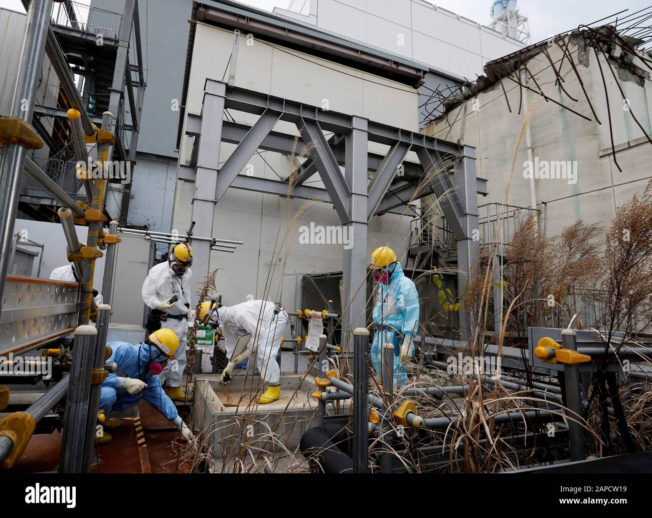 Okuma, Fukushima, Japan. 22nd Jan, 2020. Workers checks drain at Unit 4 building of tsunami-devastated Tokyo Electric Power Company (TEPCO) Fukushima Daiichi Nuclear Power Plant in Okuma town, Fukushima Prefecture, 22 January 2020. The storage tanks including water processed in the ALPS will be full around summer of 2022, TEPCO has told. Japanese government need to decide soon how manage the processed water still including tritium. Credit: Kimimasa Mayama/POOL/ZUMA Wire/Alamy Live News Stock Photo