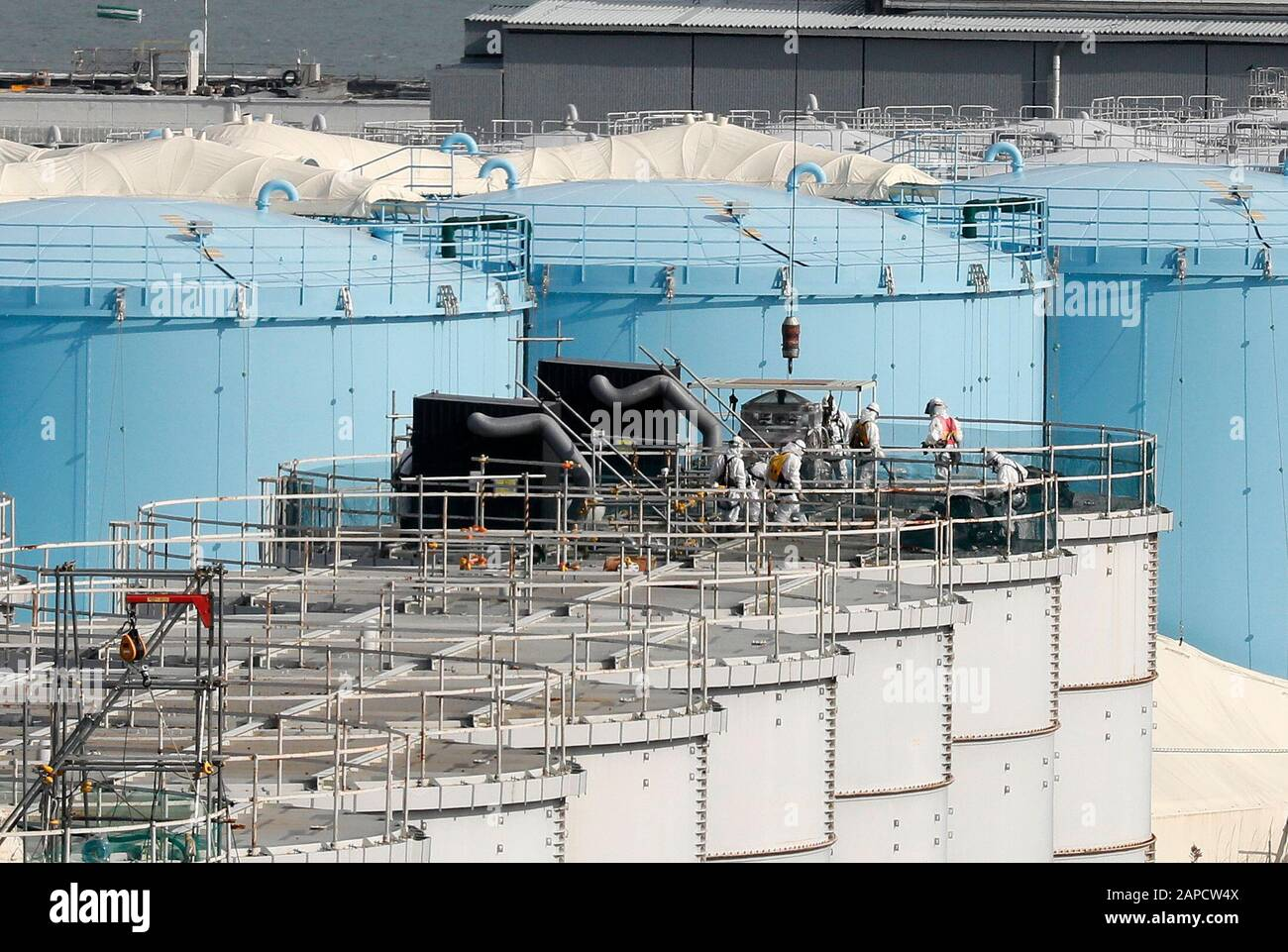 Okuma, Fukushima, Japan. 22nd Jan, 2020. Workers demolish old storage tanks included water processed in ALPS(Multi-nuclide retrieval equipment) at tsunami-devastated Tokyo Electric Power Company (TEPCO) Fukushima Daiichi Nuclear Power Plant in Okuma town, Fukushima Prefecture, 22 January 2020 after transferring to new tanks. The storage tanks including water processed in the ALPS will be full around summer of 2022, TEPCO has told. Japanese government will need to decide soon how manage the processed water still including tritium. Credit: Kimimasa Mayama/POOL/ZUMA Wire/Alamy Live News Stock Photo