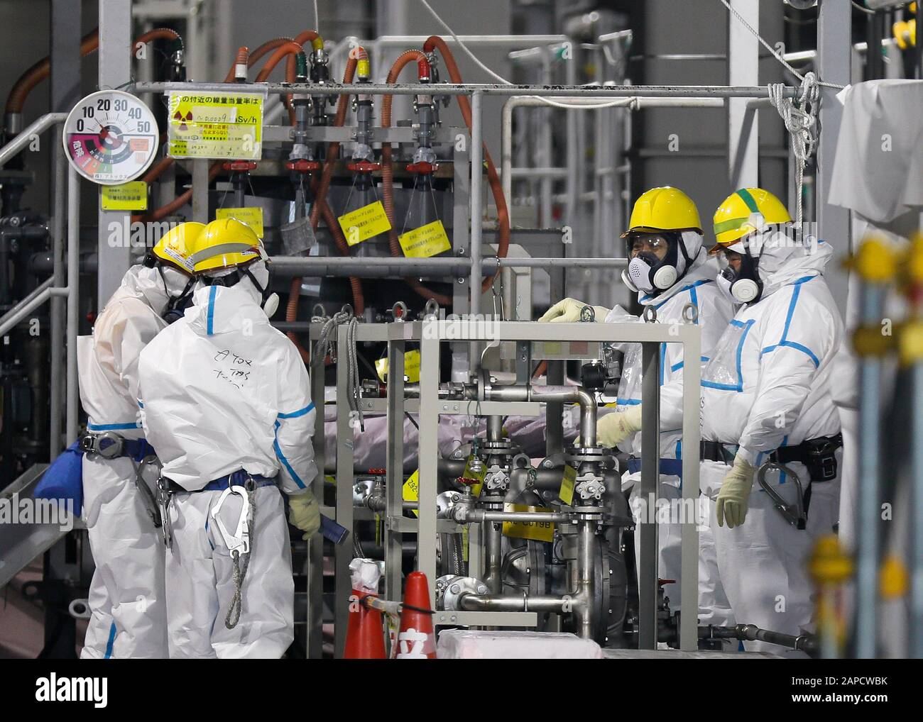 Okuma, Fukushima, Japan. 22nd Jan, 2020. Fully covered workers check water processing system ALPS(Multi-nuclide retrieval equipment) where process contaminated water to store in tanks at ALPS' house of tsunami-devastated Tokyo Electric Power Company (TEPCO) Fukushima Daiichi Nuclear Power Plant in Okuma town, Fukushima Prefecture, 22 January 2020 after transferring to new tanks. The storage tanks including water processed in the ALPS will be full around summer of 2022, TEPCO has told. Japanese government will need to decide soon how manage the processed water still including tritium. (Cred Stock Photo