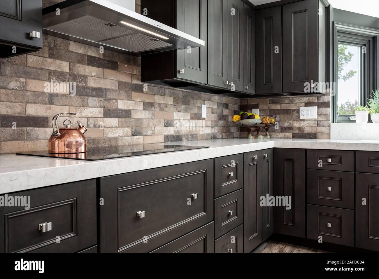 - Dark Kitchen Cabinets And Stone Backsplash Stock Photo - Alamy