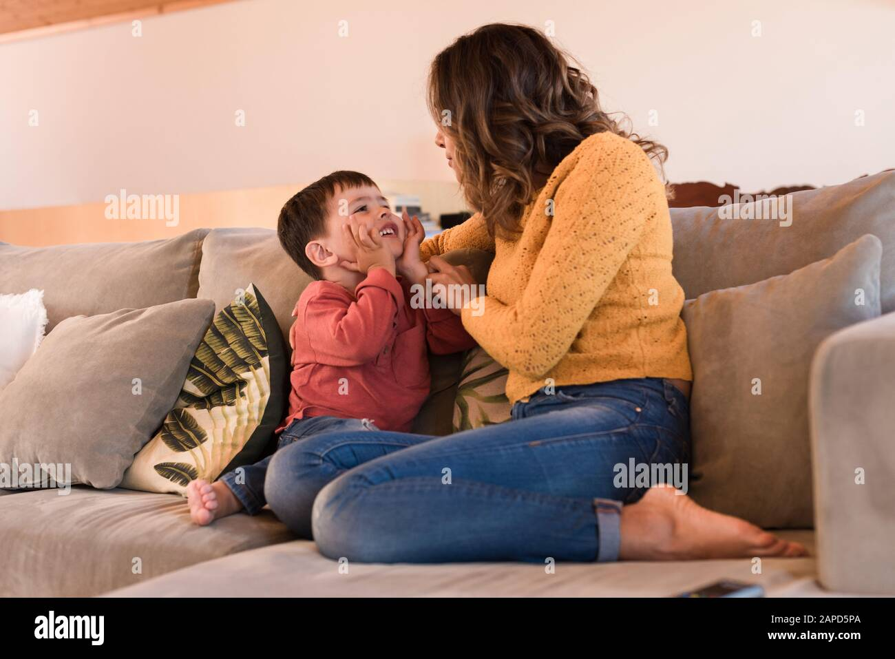 Mother and son relaxing together in the living room Stock Photo