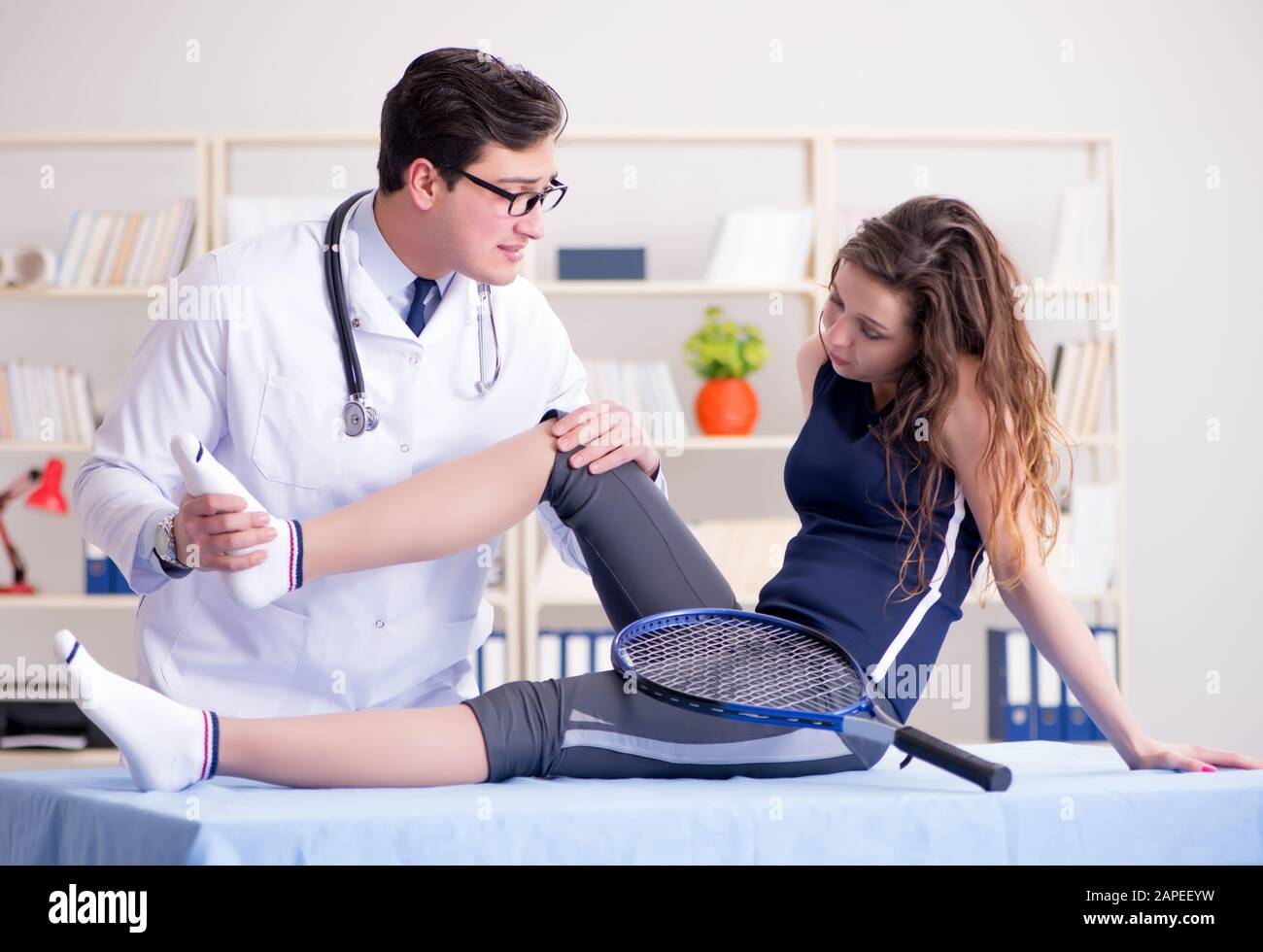 The man doctor taking care of sports injury Stock Photo