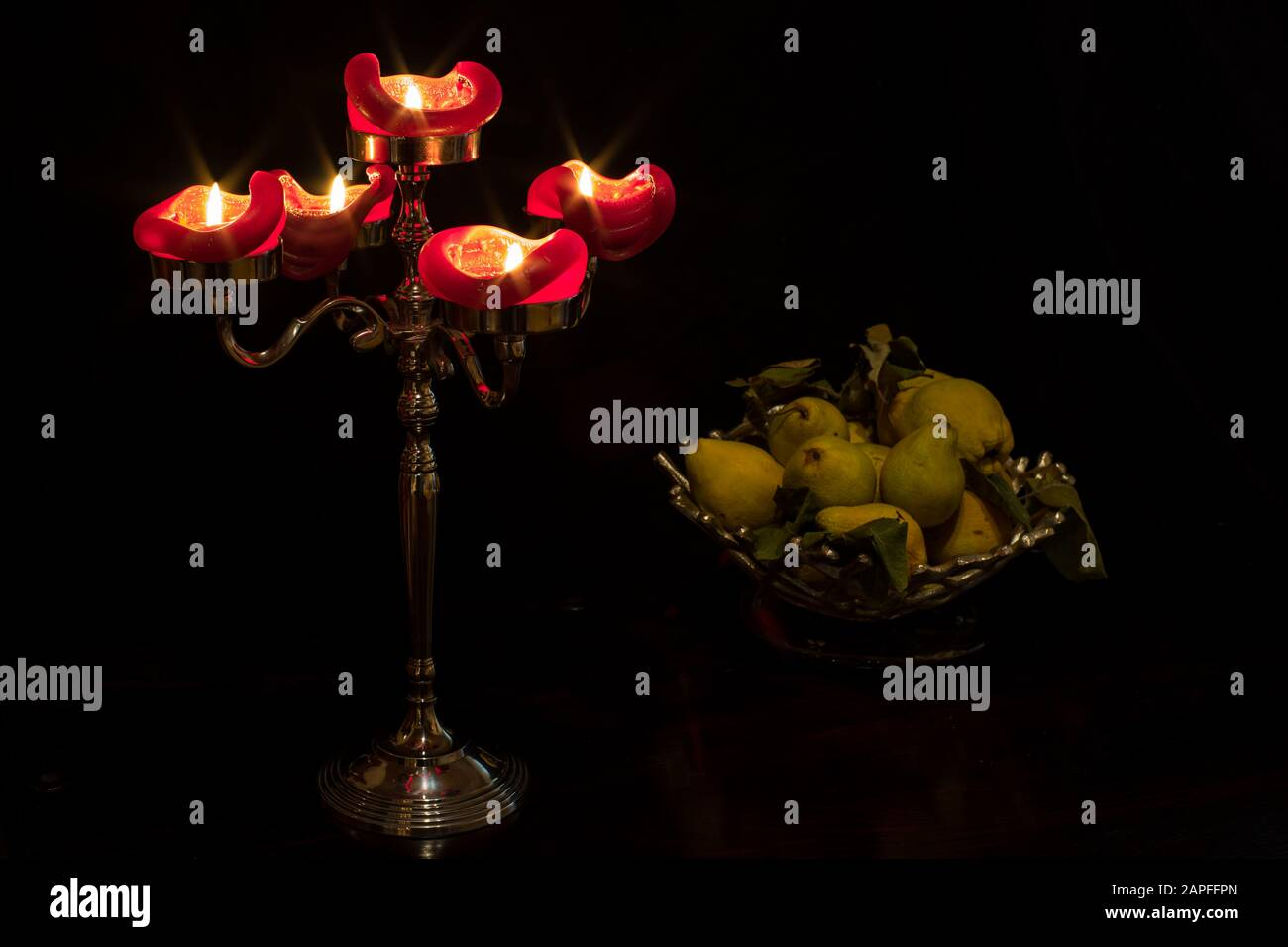 Still life with a Candelabra and a fruit basket. Stock Photo