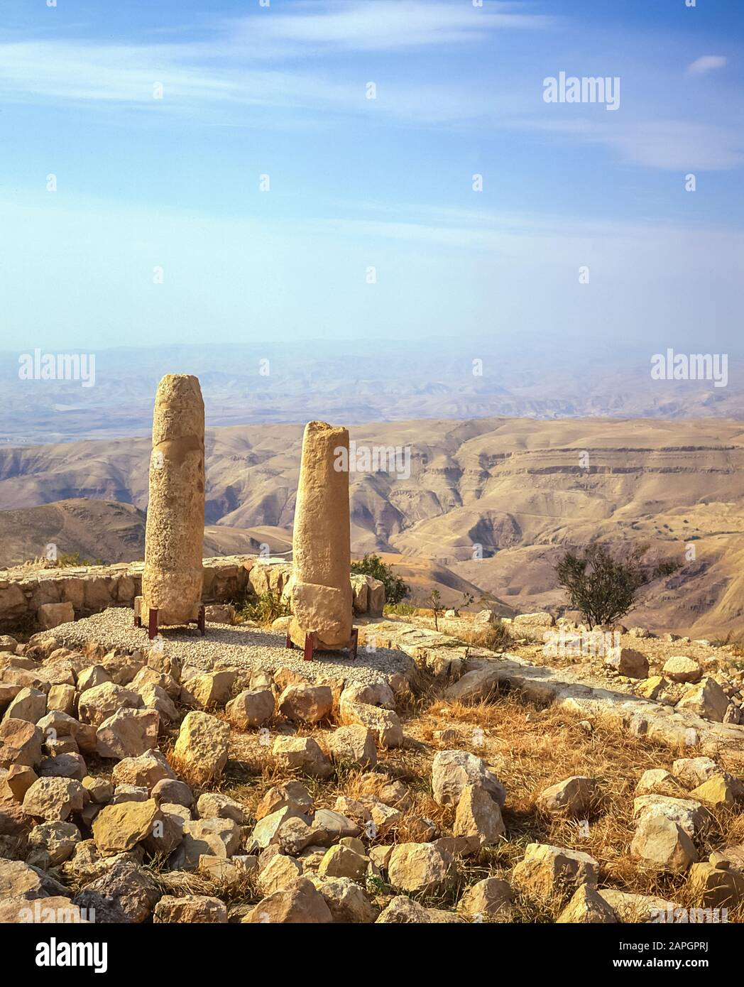 Jordan. Stone column relics at Mount Nebo overlook of the Promised Land from where  the Prophet Moses planted his staff after leading the tribe of the Children of Israel through the Negev deserts and mountains  for 40 years until he reached Mount Nebo at the present day north Jordan town of Madaba from where he declared having found the Promised Land of the River Jordan. Stock Photo