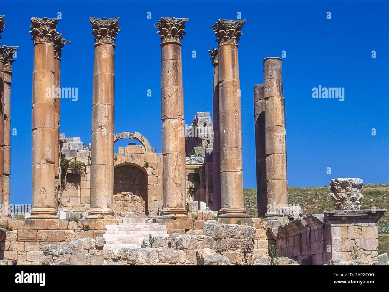 Jordan. Free standing stone columns is all that remains at the the ancient Roman City of Jerash not far from the Jordan capital city of Amman in the Middle East Stock Photo