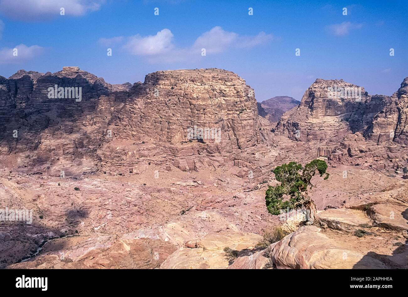 Jordan. Rugged mountain landscape overlook at the World famous UNESCO World Heritage Site of the Nabatean and Roman  ruins and relics at the desert town of Petra much used as a motion picture film set such as Indiana Jones Temple of Doom, now a very popular tourist attraction Stock Photo