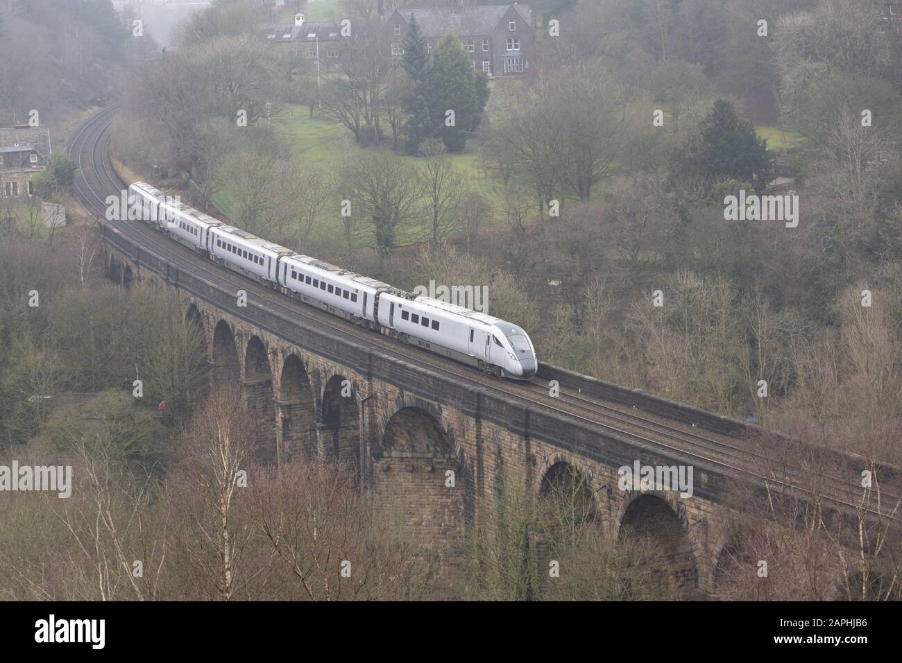 An unbranded TransPennie Express train crosses the viaduct at Brownhill, Saddleworth, Oldham heading for Manchester. Stock Photo