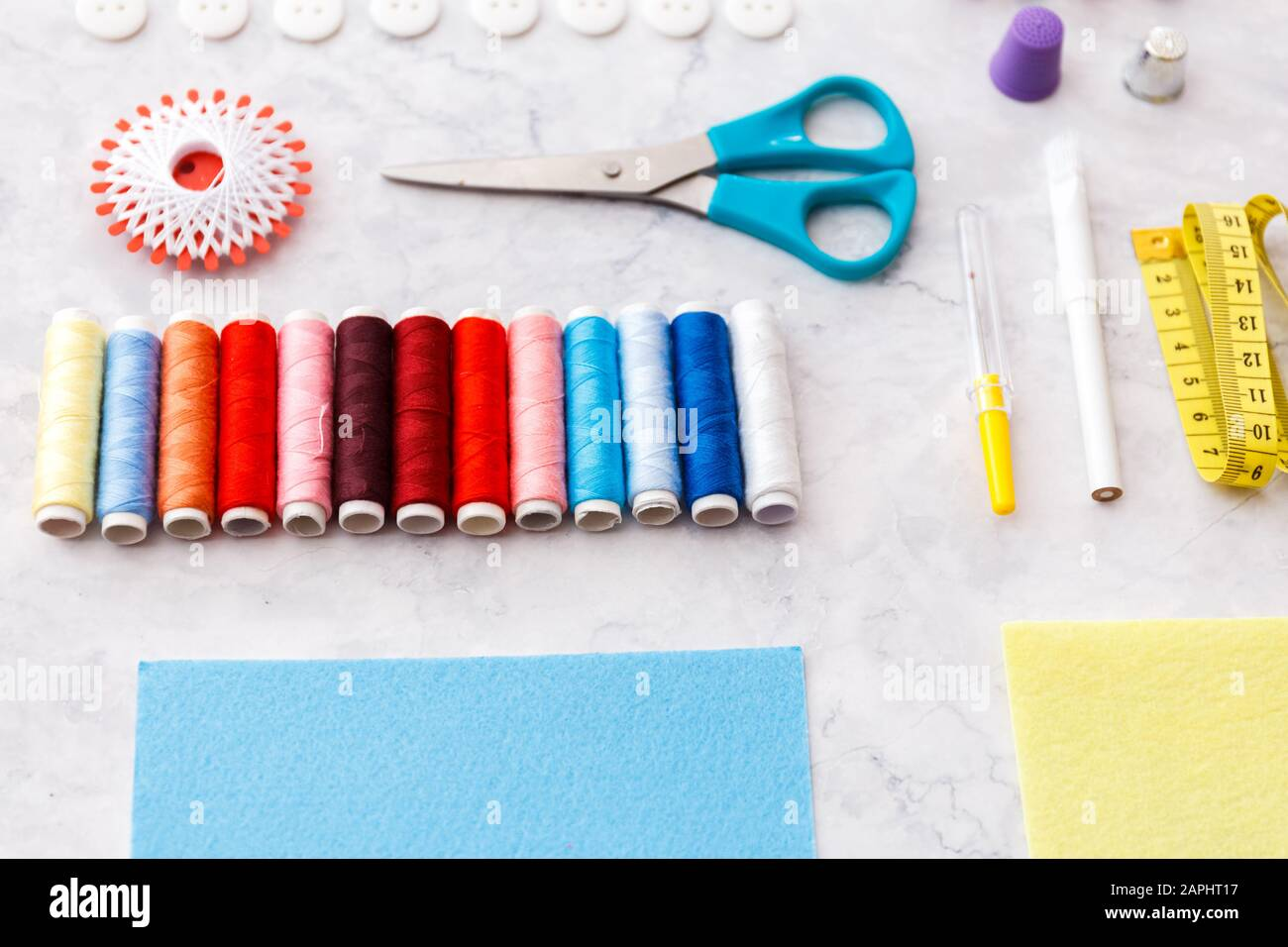 colorful sewing and tailoring tools and items on light background Stock Photo