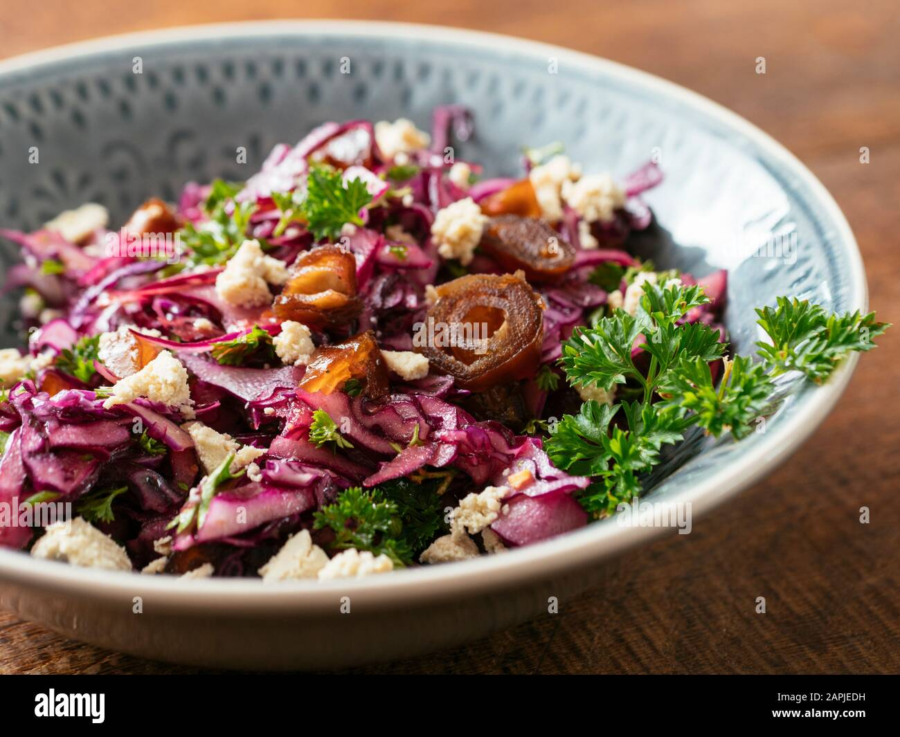 Red Cabbage Slaw with Dates and home made Vegan feta. Stock Photo