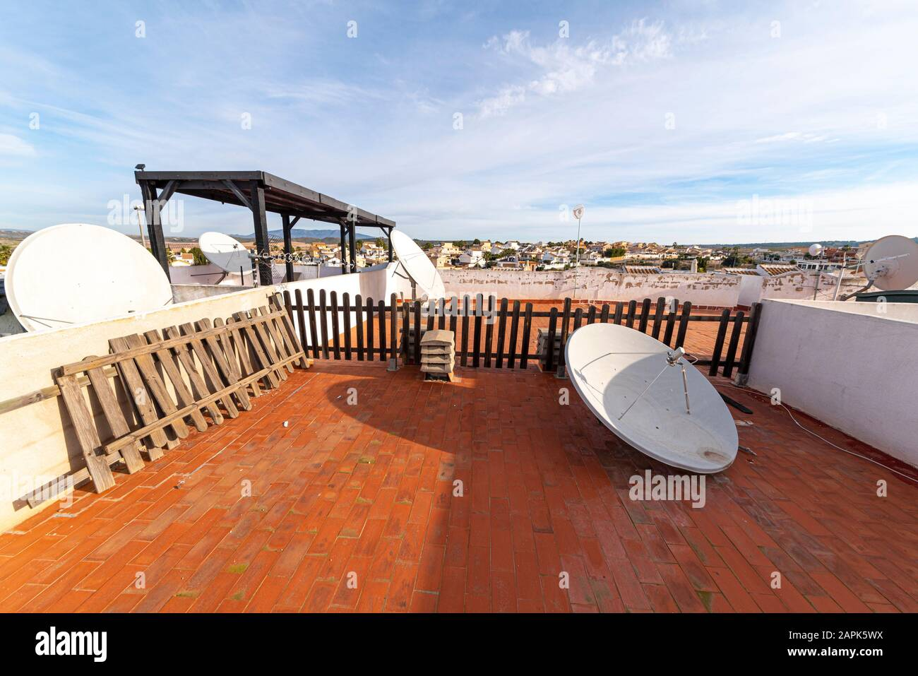 Camposol sector C in Costa Calida, Spain, EU. Camposol is a popular settlement for British ex pats in Spain. Looking over solarium and satellite dish Stock Photo