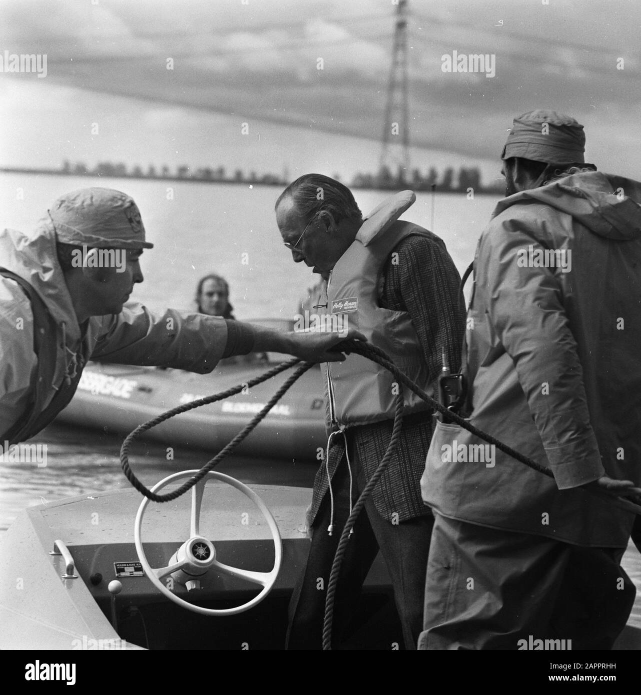 Prince Bernhard at rescue action by KNBRD on Veluwemeer Prince Bernhard hard hard in fast lifeboat on the way to the affected area Date: May 14, 1977 Location: Veluwemeer Keywords: princes Personal name: Bernhard, prince Stock Photo