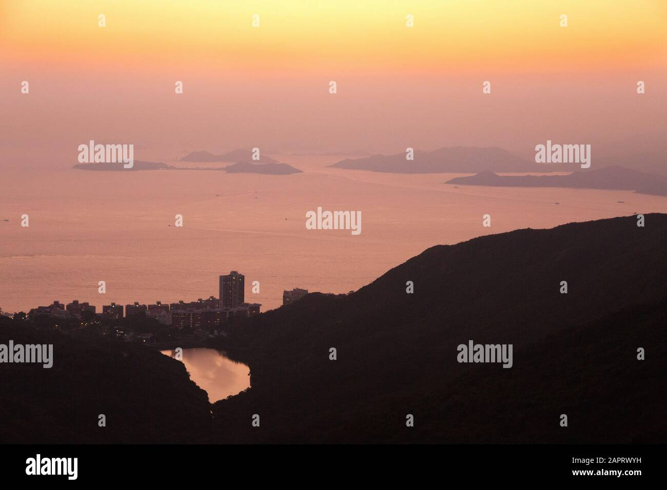 Hong Kong Islands - a view at sunset looking south-west over the islands in the South China Sea seen from the Peak, Hong Kong Island, Hong Kong Asia Stock Photo