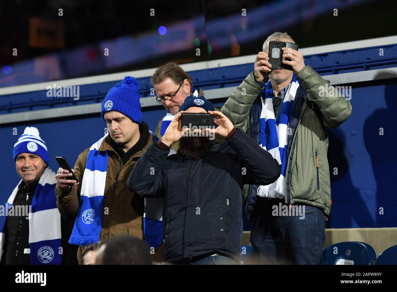 London, UK. 24th Jan 2020. QPR fans taking pictures during the FA Cup 4th Round match between Queens Park Rangers and Sheffield Wednesday at Kiyan Prince Foundation Stadium, London on Friday 24th January 2020. (Credit: Ivan Yordanov | MI News)Photograph may only be used for newspaper and/or magazine editorial purposes, license required for commercial use Credit: MI News & Sport /Alamy Live News Stock Photo