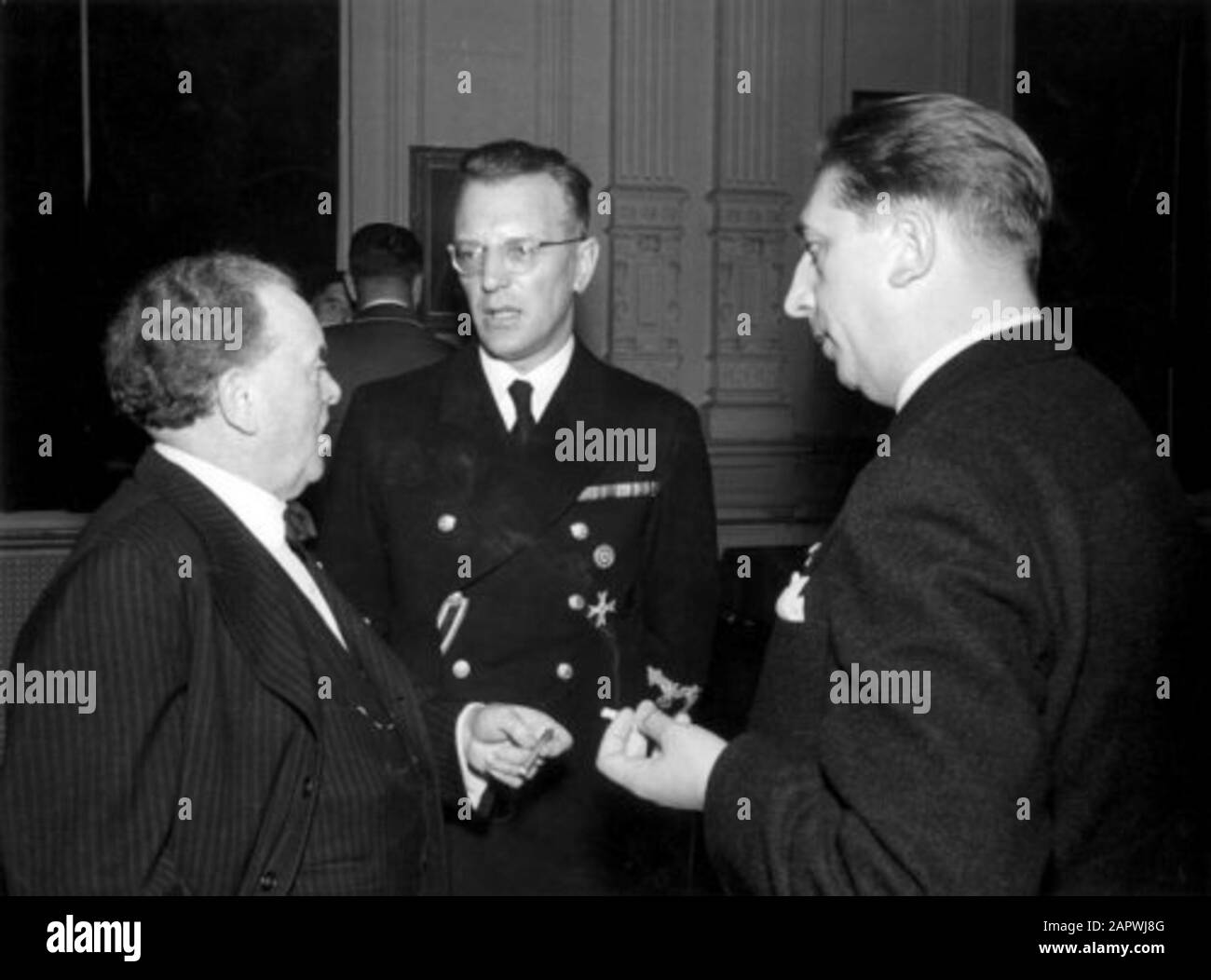 Conductor of the Concertgebouw Orchestra Willem Mengelberg (l) (1871-1951) in conversation with the high Nazi Seyss-Inquart and Prof. Jäger. Amsterdam, [1942] . Conductor Willem Mengelberg (left) talking to Reichskommissar Arthur Seyss-Inquart and Prof. Jäger. Concertgebouw Amsterdam [1942].; Stock Photo