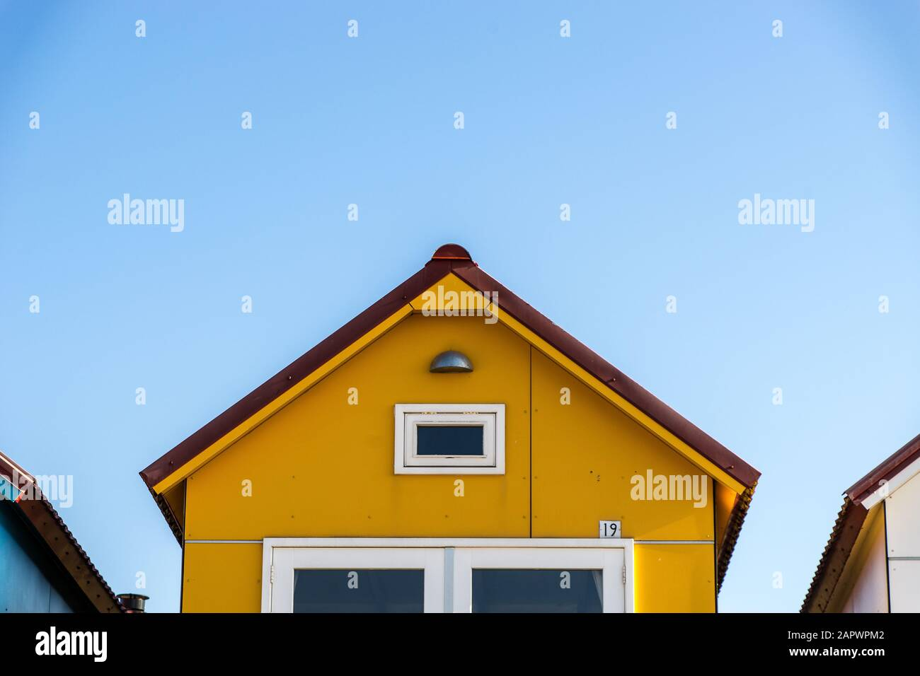 The Yellow Facade Of A Small House At The Camping De Nolle
