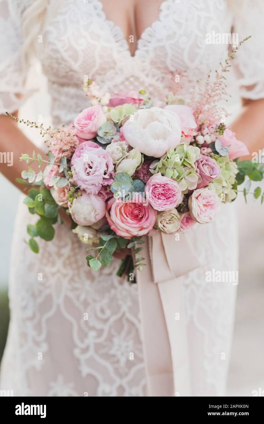 Bride Holding In Hands Small Wedding Bouquet In Pastel Colors Light Pink Roses And White Peony Stock Photo Alamy