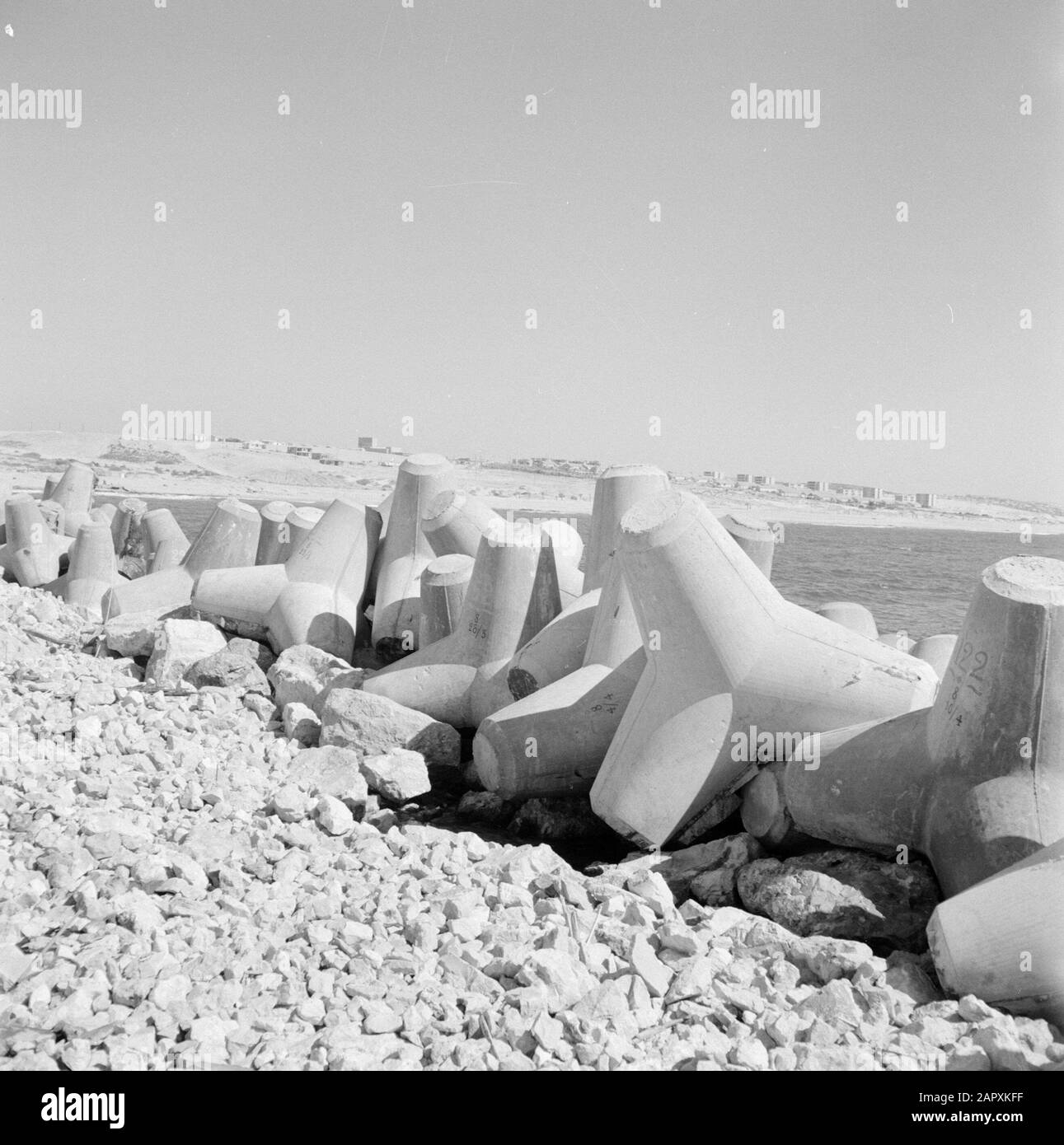 Israel 1964-1965: Ashdod, port building  Taud guards side by side of the water Annotation: Ashdod is a port town and seaside resort in western Israel, located on the Mediterranean Date : 1964 Location: Ashdod, Israel Keywords: Talud protectors, construction activities Stock Photo