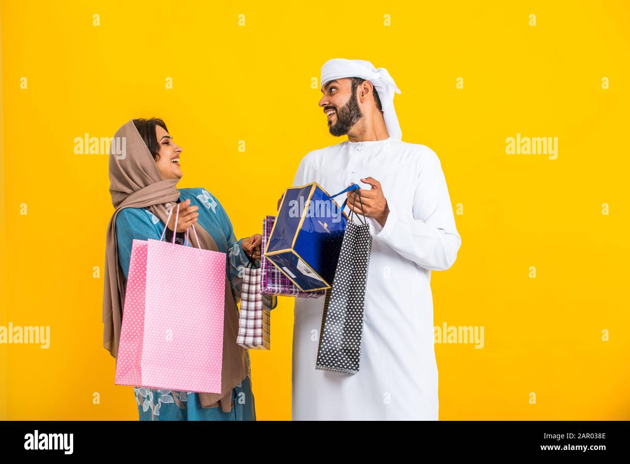 Middle Eastern Family With Traditional Emirates Dresses Posing In A Photographic Studio Concepts About Lifestyle Happiness And Family Relationship Stock Photo Alamy