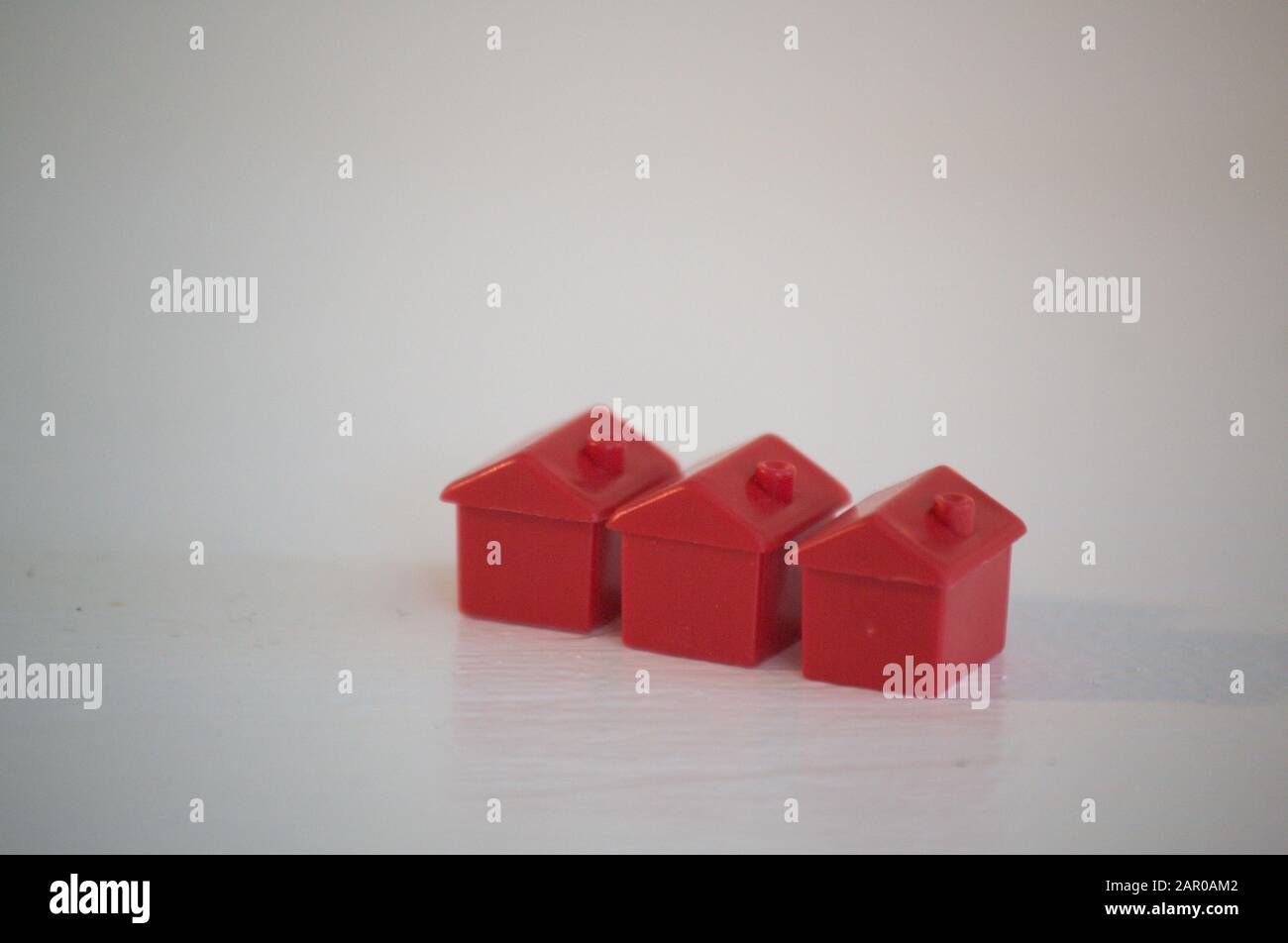 Monopoly Houses concept, white background Stock Photo