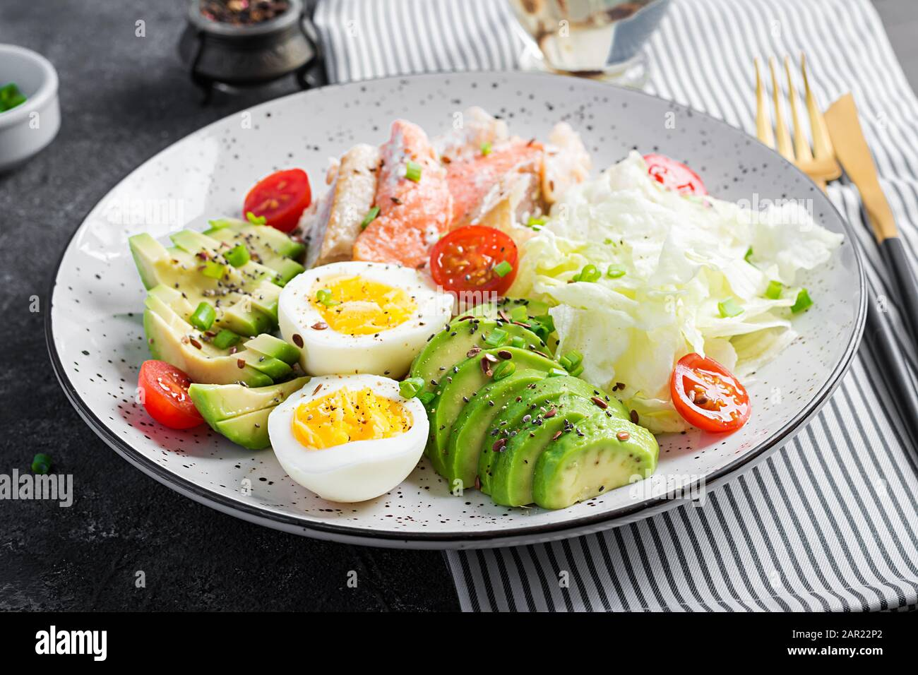 Ketogenic Diet Breakfast Eggs Fish And Avocado Lettuce And Seeds Low Carb High Fat Breakfast Keto Paleo Menu Stock Photo Alamy