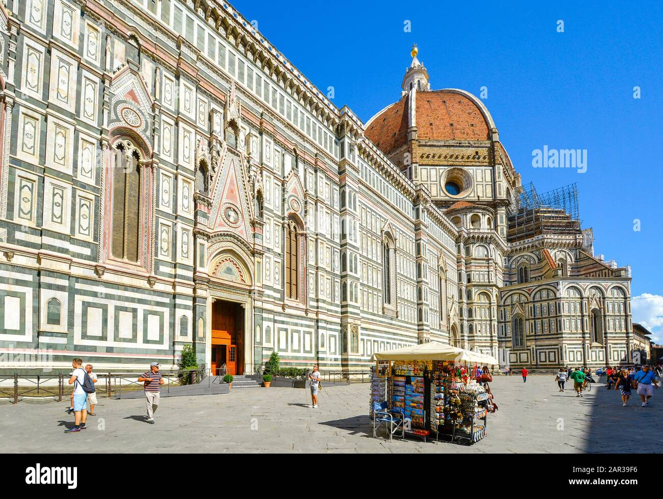 A souvenir booth outside the Florence Cathedral or Cattedrale di Santa Maria del Fiore in the Piazza del Duomo in the Tuscan region of Florence Italy Stock Photo