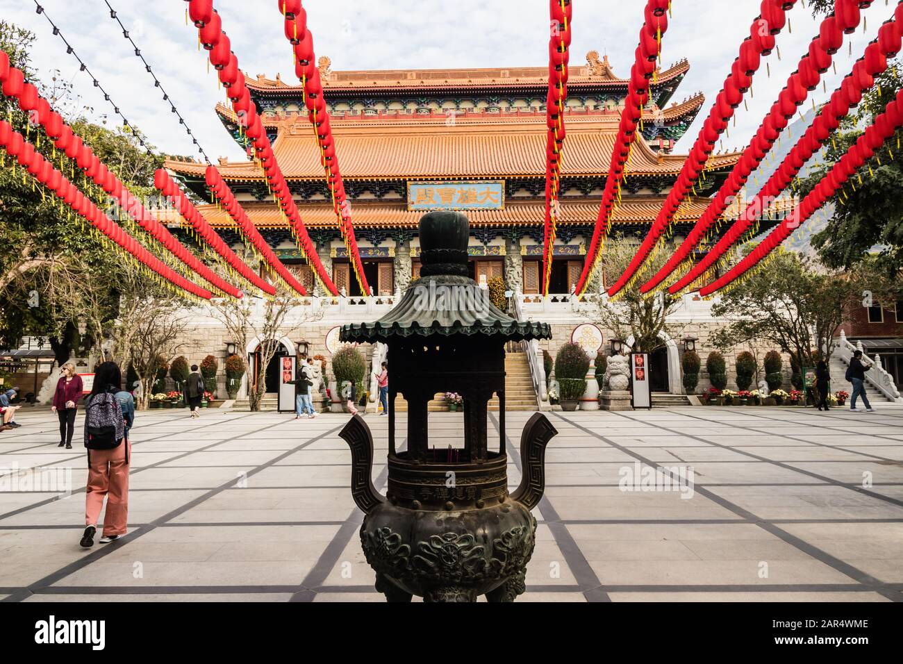 Po Lin Monastery courtyard with traditional Chinese New Year decorations and Hall of Great Hero, Lantau Island, Hong Kong Stock Photo