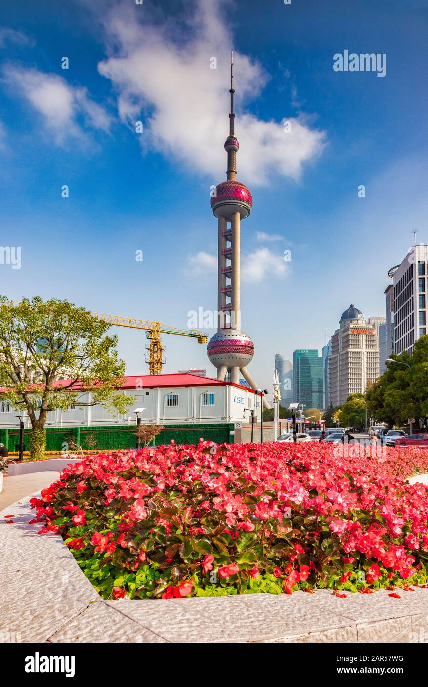 1 December 2018: Shanghai, China - Flower beds in front of the Oriental Pearl telecommunications Tower, in the Pudong district of Shanghai, China. Cra Stock Photo