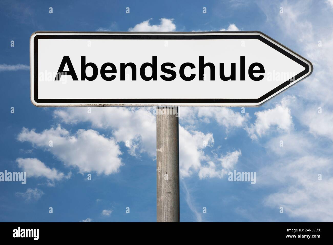 Detail photo of a signpost with the inscription Abendschule (evening classes) Stock Photo