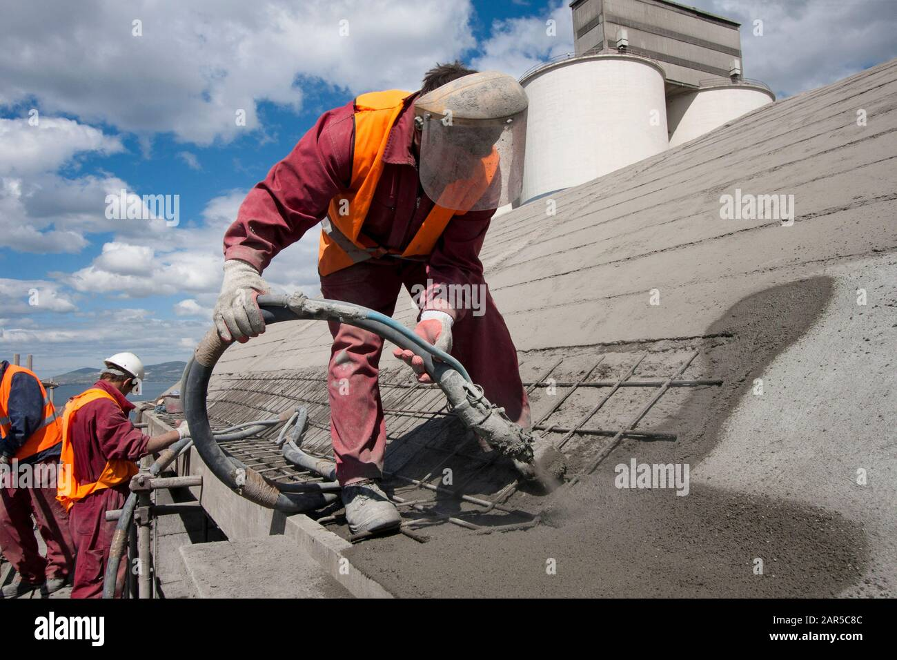 Renewing roof of industrial hale with sprayed concrete Stock Photo