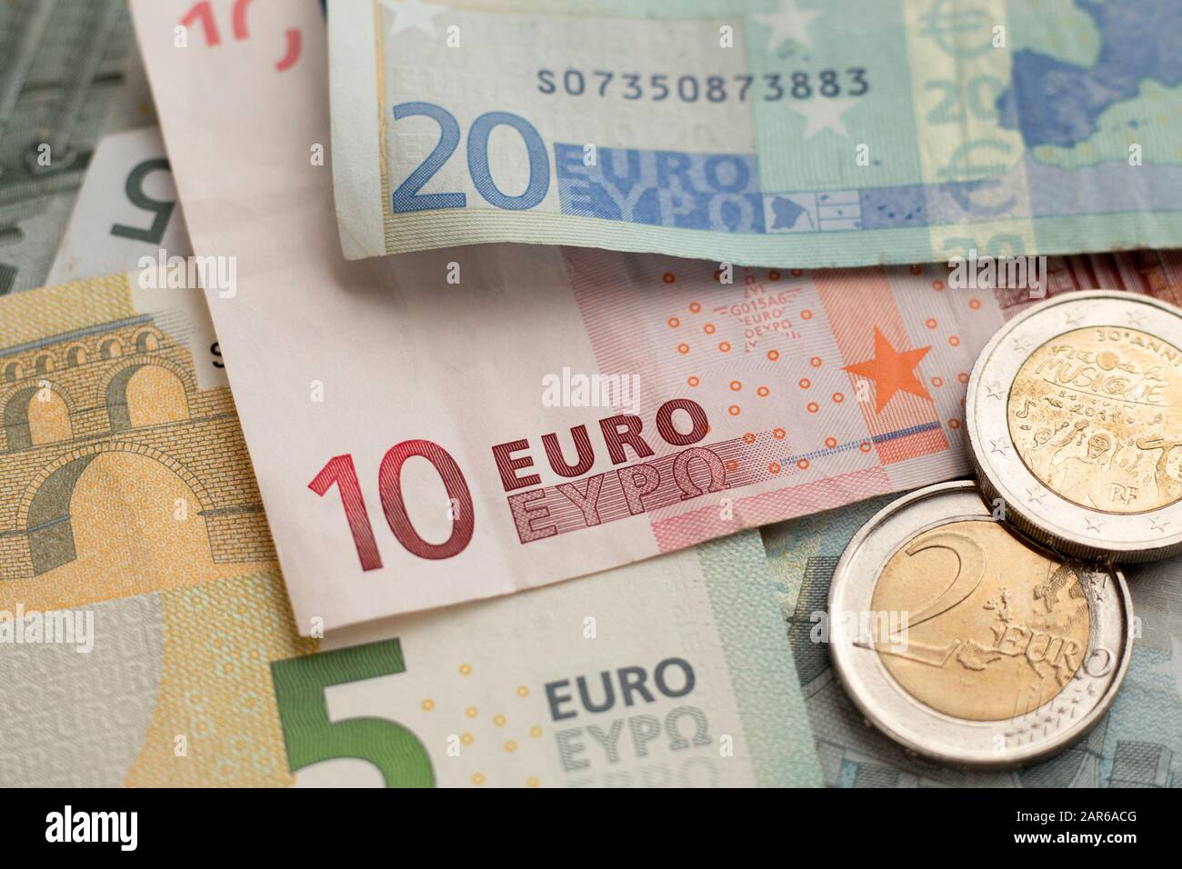 Tax planning concept for business, finance, banking, budgeting, economic topics. Euro paper banknotes and coins background. Selective focus Stock Photo