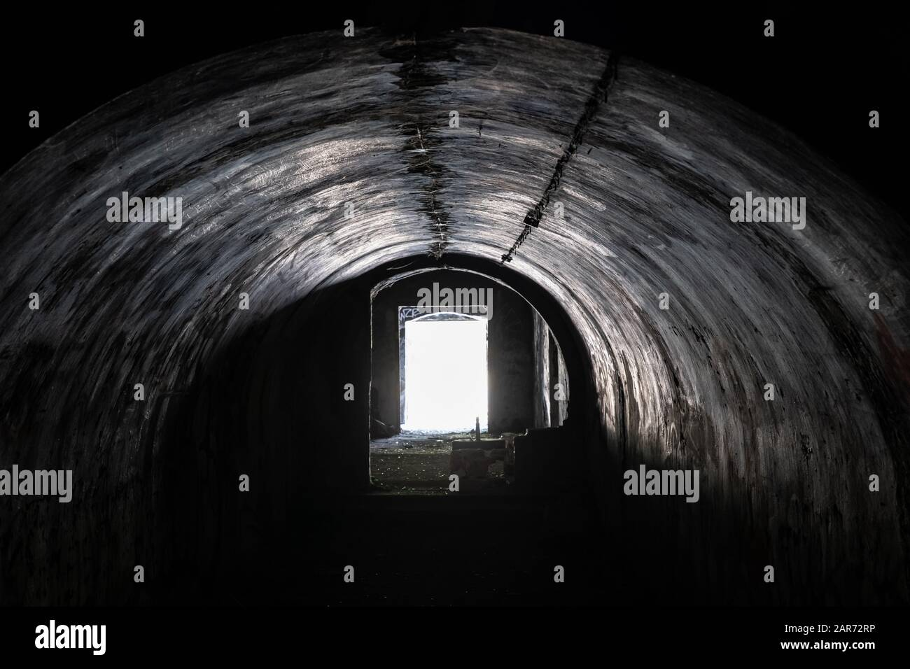 Spooky, creepy arched passage in an abandoned building, old military fort interior concrete structure, urban exploration Stock Photo