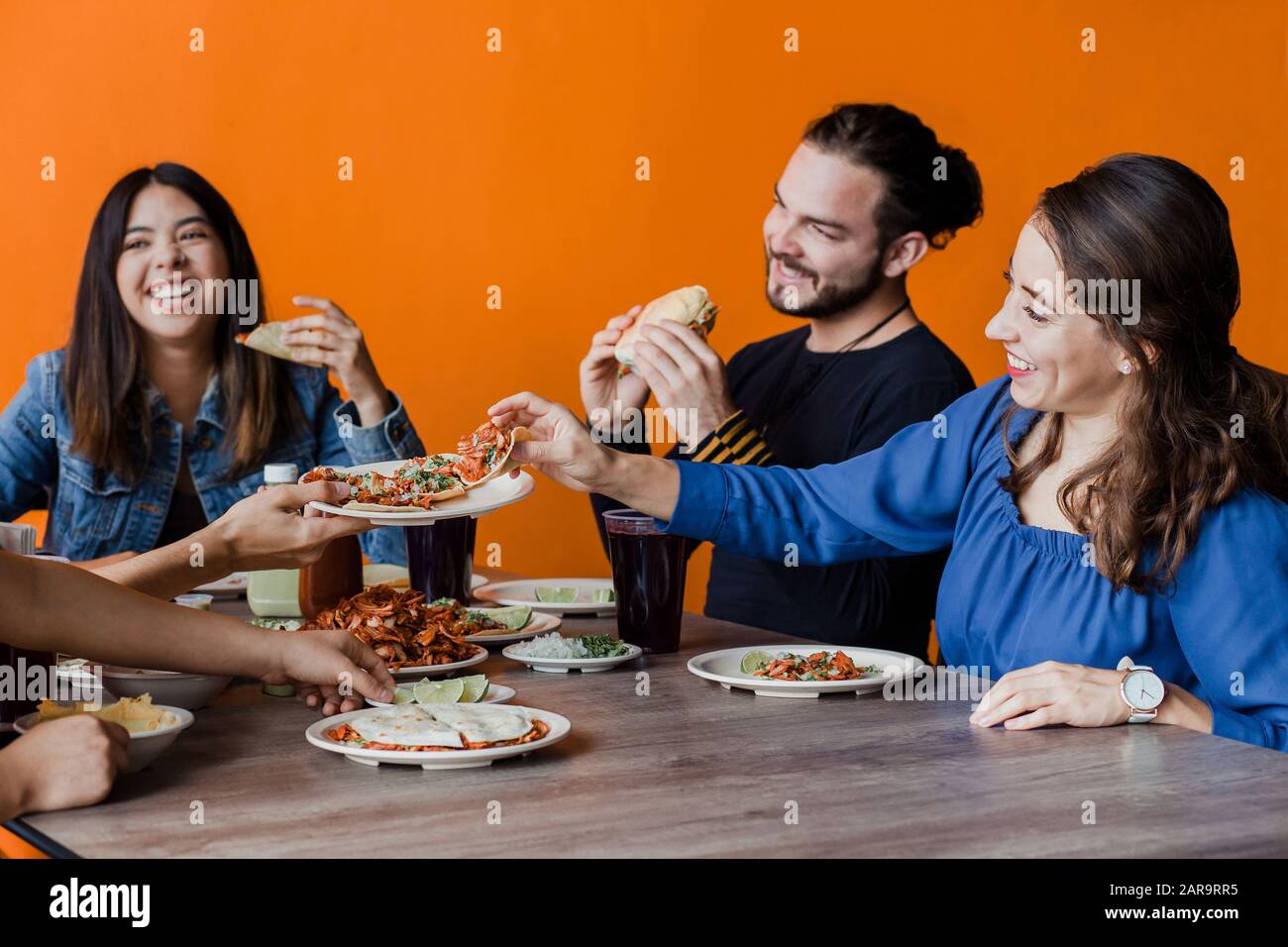Mexican people eating Tacos al Pastor in a Taqueria in Mexico city Stock Photo