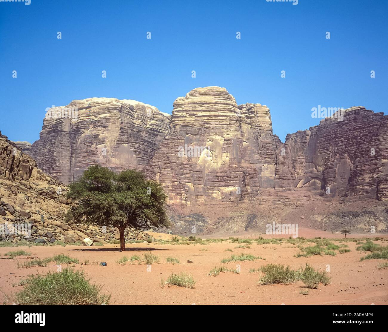 Jordan. Colourful desert mountain landscapes at the UNESCO World Heritage Site of Wadi Rum near the port of Aqaba in southern Jordan  associated with  Lawrence of Arabia. Stock Photo