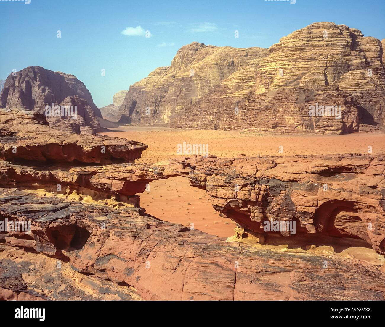 Jordan. Colourful desert mountain landscapes at the rock arch of Al Kharza at the UNESCO World Heritage Site of Wadi Rum near the port of Aqaba in southern Jordan Stock Photo