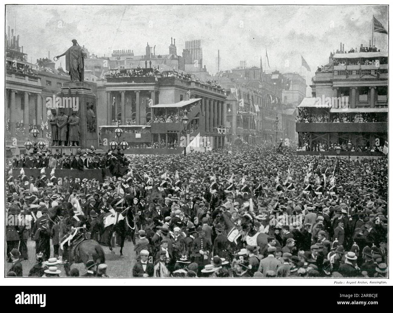 London crowds outside Waterloo Place, celebrating years later the victory, raised to commemorate the heroism of the Brigade of Guards in the Crimean War. Around the foot of the statue a group of veteran soldiers wearing their medals standing, glad to be there to testify their loyalty to Queen Victoria.     Date: 1899 Stock Photo