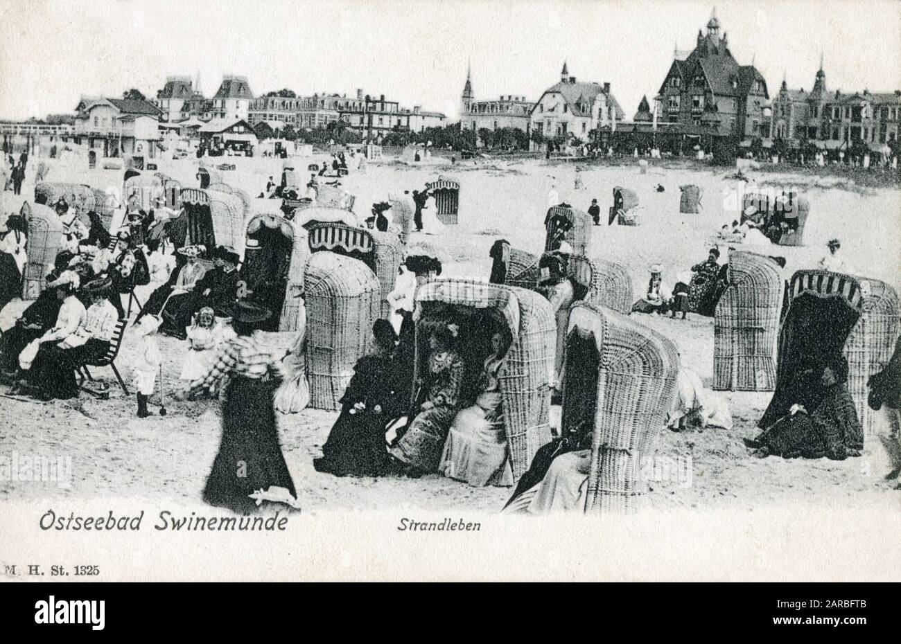 Bathers with their marvelous wickerwork seats on the beach at the Baltic Sea Coastal resort of Swinoujscie, Poland (formerly Swinemunde in German Prussia)     Date: 1905 Stock Photo