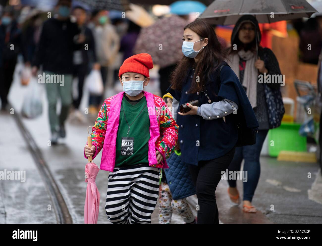 Hong Kong, China. 27th Jan, 2020. North Point Markets are open during Lunar New Year with many taking advise to wear surgical masks against the novel CoronaVirus from China. Others ignore warnings despite on of the local cases involving a North Point man.Shoppers at the market wear masks. Alamy Stock Image/Jayne Russell Credit: Jayne Russell/Alamy Live News Stock Photo