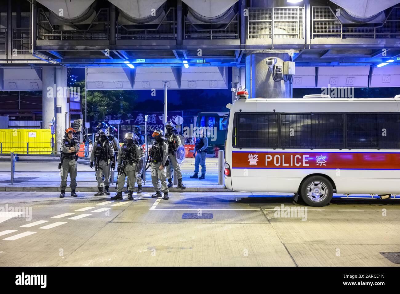 Hong Kong - Jan 21, 2020:  Peaceful sit down at Yuen Long MTR station. Protestors sticking up sign. Stock Photo